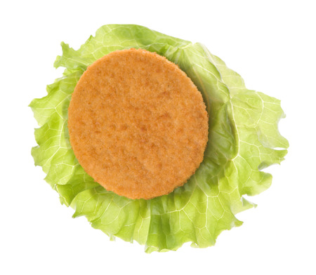 beefburger: patty on lettuce isolated on a white background. top view