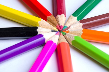 secretarial: colored pencils arranged in a circle. view from above . Stock Photo
