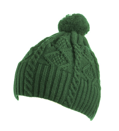 pompom: green knitted hat with pompom isolated on white background .