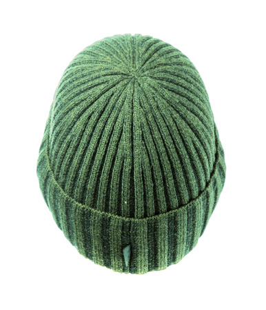 beanie: green knitted beanie  isolated on white background . Stock Photo