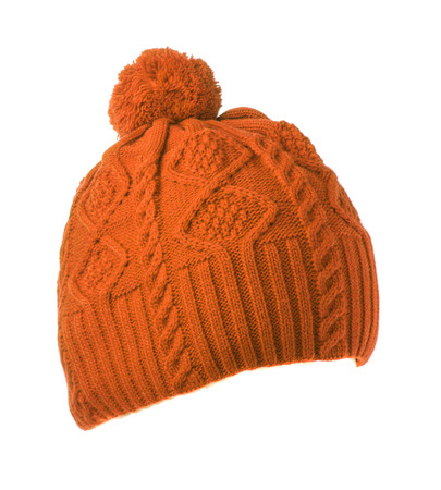 pompom: orange knitted hat with pompom isolated on white background .