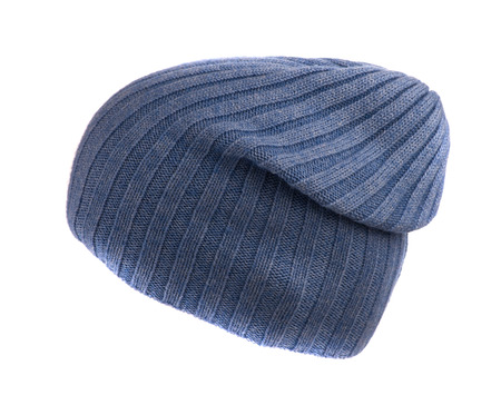 beanie: blue knitted beanie  isolated on white background .