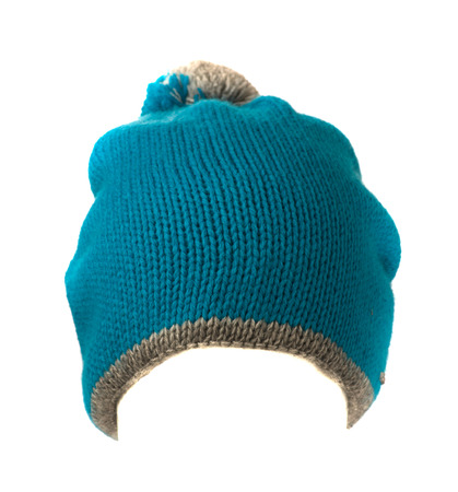 pompom: blue knitted beanie with pompom  isolated on white background .