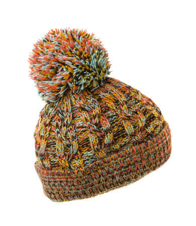 pompom: colorful knitted hat with pompom isolated on white background . Stock Photo
