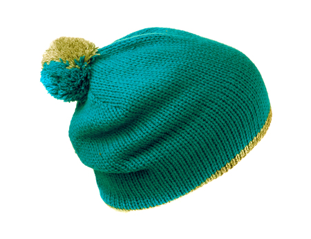 pompom: knitted hat with pompom green isolated on white background . Stock Photo