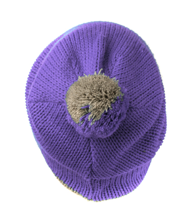 pompon: knitted hat with pompon purple isolated on white background .