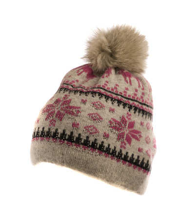 pompon: knitted hat with pompon isolated on white background . Stock Photo