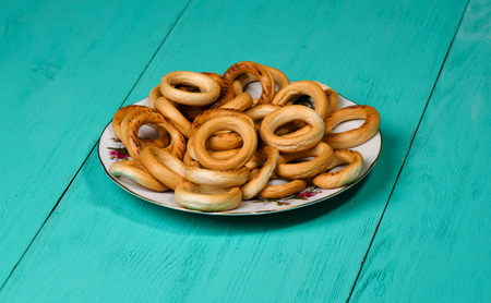 bublik: bagels on a wooden table. Rustic style.  Free space for text.