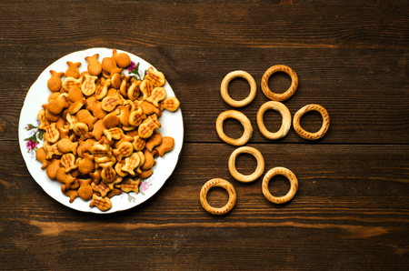 salty: Crackers on a wooden table. Rustic style . Top view. Free space for text. Stock Photo