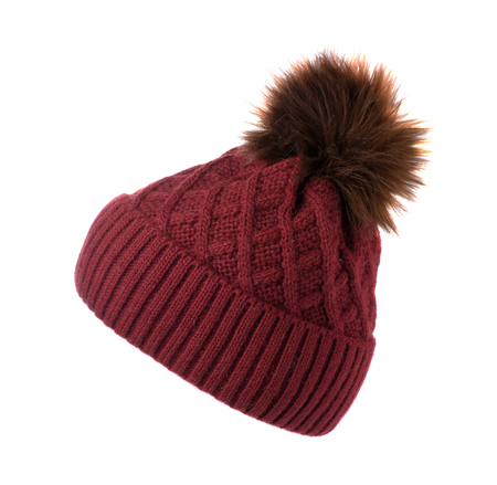 knitted hat with pompom isolated on white background .