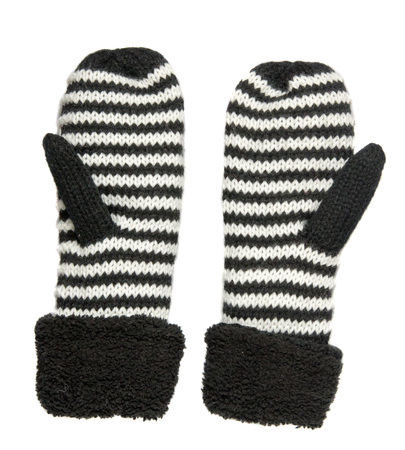 mittens: Mittens isolated on white background. Knitted mittens. Mittens top view.mittens is black with white stripes . Stock Photo