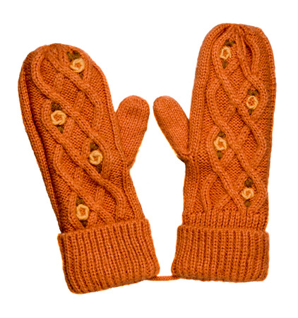 Mittens isolated on white background. Knitted mittens. Mittens top view.ginger mittens with pattern