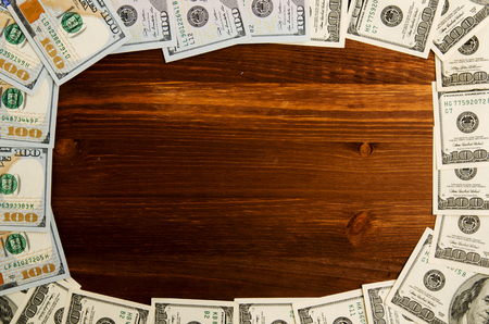 Dollars on a wooden background. dollar top view .