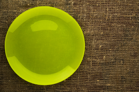plate on a wooden background.yellow plate. plate top view. copy space .