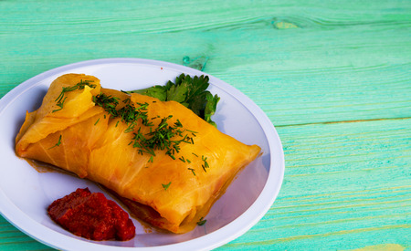 filled roll: cabbage rolls on a plate. cabbage rolls top view .