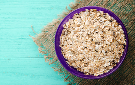 nourishing:  muesli on a wooden table. muesli top view . healthy food