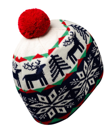 knitted hat isolated on white background.hat with red pompon .blue white hat