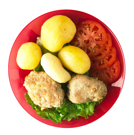 cutlet with potatoes on a plate. cutlet with potatoes isolated on white background