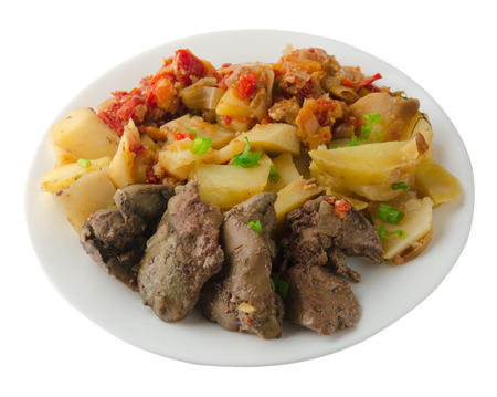 higado de pollo:  fried liver with potatoes and stewed tomatoes. fried liver on plate   isolated on white background