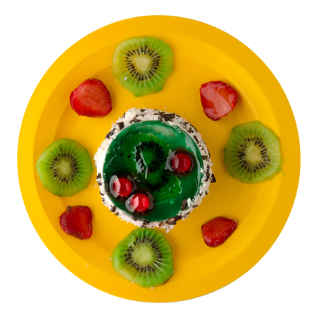 dessert cake with kiwi and strawberries  isolated on white background. festive dessert on a plate top view