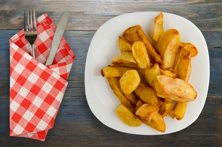 fry potatoes on a wooden background. fry potatoes on a plate 写真素材