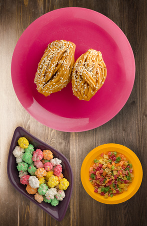 cakes with sesame seeds on a plate top view. cakes with sesame seeds on a wooden background