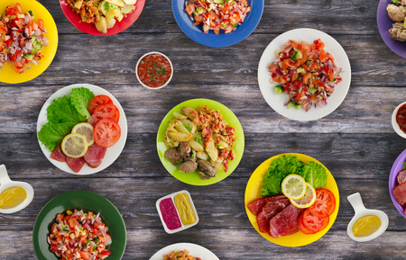 meat dishes on a plate. salads on a plate. the abundance of food on the table. food top view