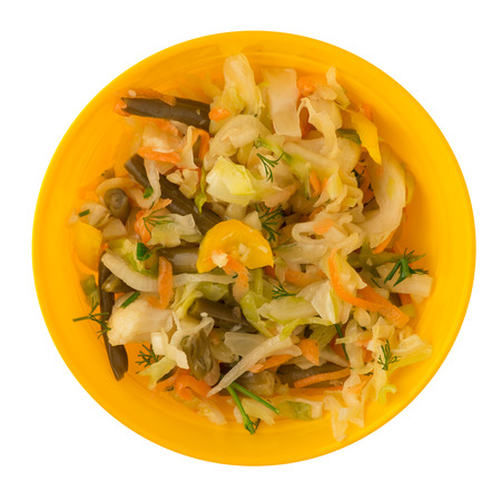 marinated vegetables on a plate isolated on a white background. seafood, cabbage, parsley, pepper on a plate top view