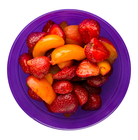 strawberry and apricot sliced on a plate isolated on white background. strawberry and apricot sliced on a plate top view. healthy food