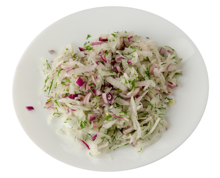 salad daikon, onions and dil isolated on white background. salad on a plate