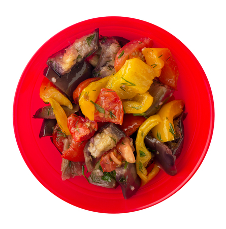 saute from eggplant isolated on white background. eggplants, peppers, tomatoes, dill on a plate. healthy food. healthy food