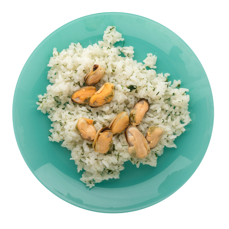 White rice with mussels on a plate. Rice with mussels  isolated on white background. rice top view