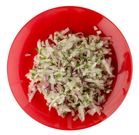 salad daikon, onions and dil isolated on white background. salad on a plate . vegetarian food