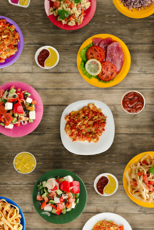 Pasta with vegetables and sauce on a table. Spaghetti on a plate. Mediterranean food