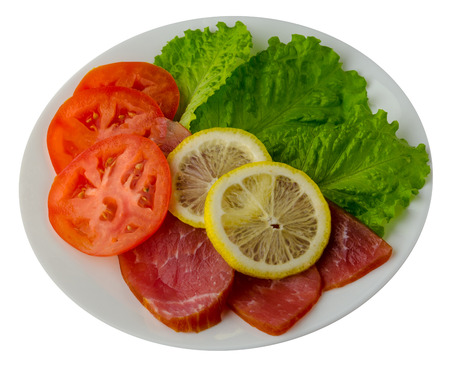 ham with salad, tomato and lemon on a plate. ham  isolated on white background .ham top view