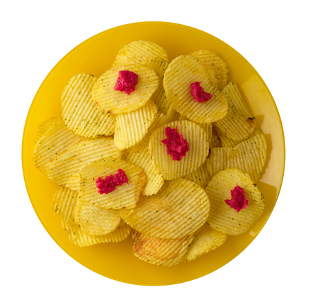 potato chips on a plate. potato chips isolated on white background.