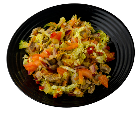 salad with chicken stomachs with vegetables (carrots, onions, peppers, cabbage, tomato, broccoli). salad with chicken on a plate  isolated on white background 스톡 콘텐츠