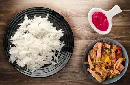 daikon on a wooden background. daikon on a plate