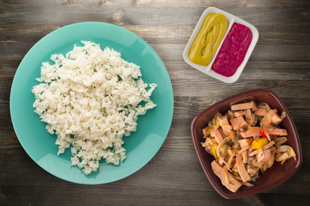 white rice on a plate. rice on a wooden background top view . Stock Photo