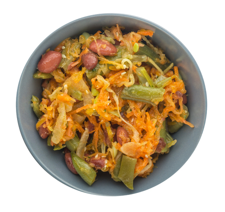 Vegetarian salad. Healthy food. Salad of beans, asparagus, onion, carrot and sesame on a plate isolated on a white background.