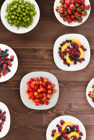 fruits on a plate. vegetarian food on wooden background. vegan food top view . Imagens