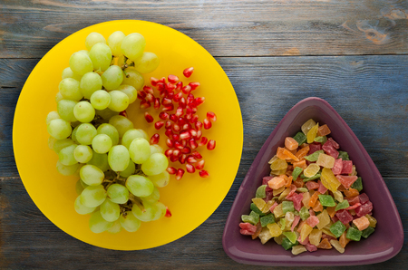 grapes, pomegranate isolated on white background. grapes, pomegranate on a plate 写真素材