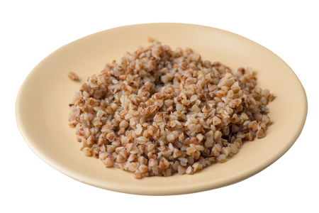 buckwheat in a beige  plate isolated on white background. buckwheat top side view. Healthy food. veretian food Stock Photo