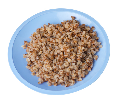 buckwheat in a blue  plate isolated on white background. buckwheat top side view. Healthy food. veretian food