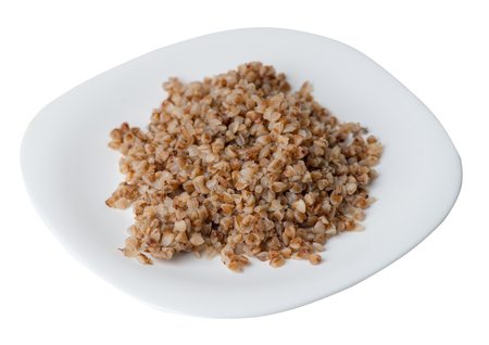 buckwheat in a white plate isolated on white background. buckwheat top side view. Healthy food. veretian food