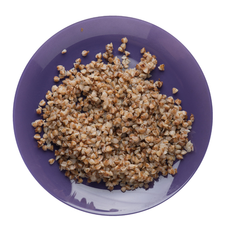 buckwheat in a purple plate isolated on white background. buckwheat top view. Healthy food. veretian food