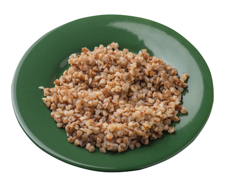 buckwheat in a green plate isolated on white background. buckwheat top side view. Healthy food. veretian food