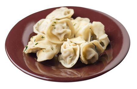 dumplings on a brown plate isolated on white background