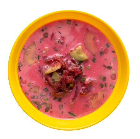 Beetroot soup in a yellow plate isolated on white background.