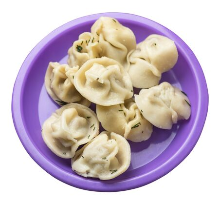 dumplings on a purple plate isolated on white background